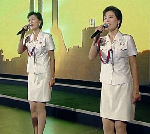 Ri Myong-hui Kim Yu-kyong 20140904 32.42